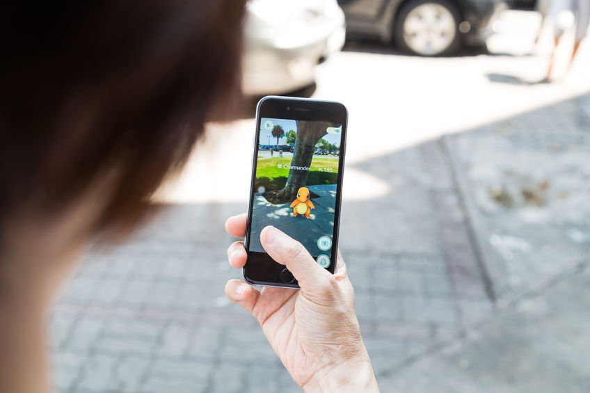 59473012 - kuala lumpur, malaysia, july 16, 2016: an ios user plays pokemon go, a free-to-play augmented reality mobile game developed by niantic for ios and android devices.